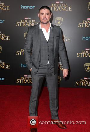 Karl Urban and Katee Sackhoff seen at the premiere of Disney And Marvel Studios' new movie 'Doctor Strange' held at...