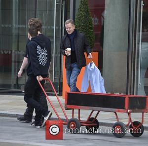 TV presenter Jeremy Kyle has a close encounter as he nearly walks into a trolley whilst drinking his coffee as...