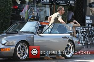 Jesse Metcalfe seen getting out of a sports car to pick up a coffee from Alfred on Melrose Place, West...