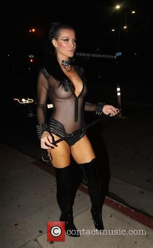 Joanna Krupa wears a sexy dominatrix outfit as she arrives at a Halloween party in Los Angeles, California, United States...