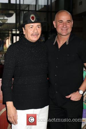 Carlos Santana and Andre Agassi