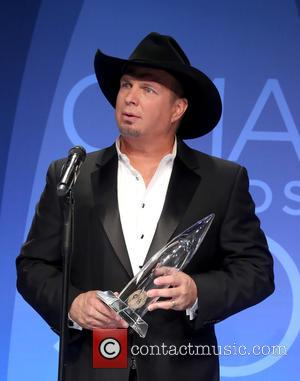 Garth Brooks holding his award in the press room at the 50th Annual CMA Awards held at Brigestone Arena, Nashville,...