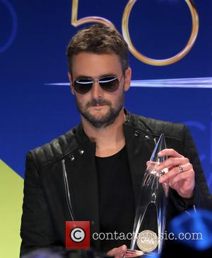 Eric Church holding his award in the press room at the 50th Annual CMA Awards held at Brigestone Arena, Nashville,...