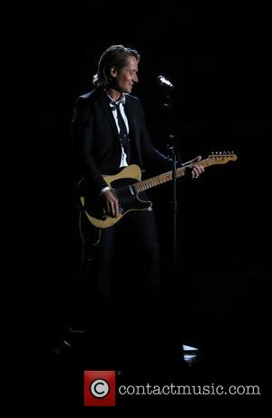 Keith Urban on stage at the 50th annual CMA (Country Music Association) Awards held at Music City Center in Nashville,...