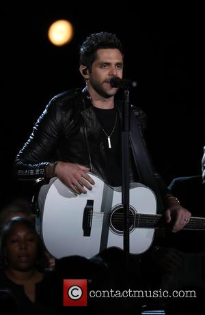 Thomas Rhett on stage at the 50th annual CMA (Country Music Association) Awards held at Music City Center in Nashville,...