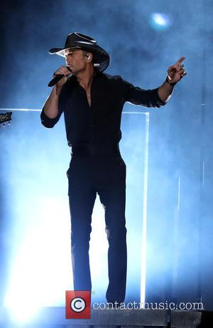 Tim McGraw on stage at the 50th annual CMA (Country Music Association) Awards held at Music City Center in Nashville,...