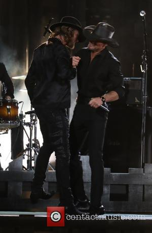 Brian Kelly and Tim Mcgraw