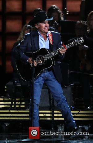 George Strait on stage at the 50th annual CMA (Country Music Association) Awards held at Music City Center in Nashville,...