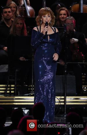 Reba McEntire on stage at the 50th annual CMA (Country Music Association) Awards held at Music City Center in Nashville,...