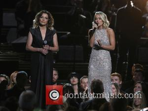 Martina McBride and Carrie Underwood on stage at the 50th annual CMA (Country Music Association) Awards held at Music City...