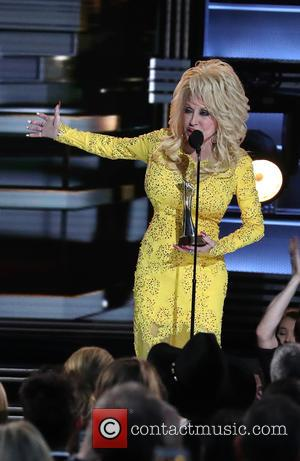 Dolly Parton on stage at the 50th annual CMA (Country Music Association) Awards held at Music City Center in Nashville,...