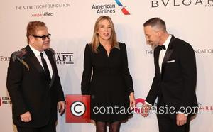 Sir Elton John seen alone and with David Furnish and Diana Krall arriving at his 15th annual AIDS Foundation benefit...