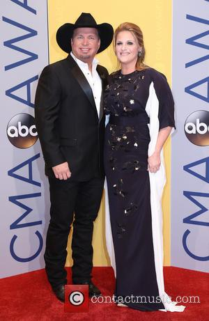 Garth Brooks and Trisha Yearwood seen arriving at the 50th annual CMA (Country Music Association) Awards held at Music City...