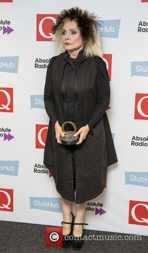 Debbie Harry of Blondie seen holding her award in The 2016 StubHub Q Awards press room. Blondie won the 2016...