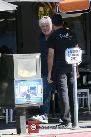 Ron Perlman seen getting into his new Tesla Model S after breakfast at Toast Bakery, Los Angeles, California, United States...