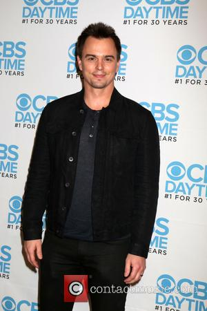 Darin Brooks seen alone and with Scott Clifton, Bradley Bell, Jacob Young and John McCook  at a celebration hosted...