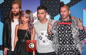 DNCE (Joe Jonas, Jack Lawless, JinJoo Lee and Cole Whittle) arriving at the 2016 MTV Europe Music Awards (EMAs) held...