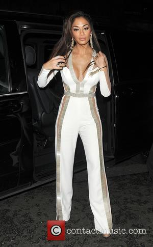 Nicole Scherzinger seen wearing a revealing outfit as she leaves 45 Park Lane after dinner with friends. - London, United...