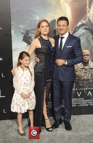 Amy Adams seen alone and with Darren Le Gallo at the Film Premiere of Arrival held at the Village Theater...