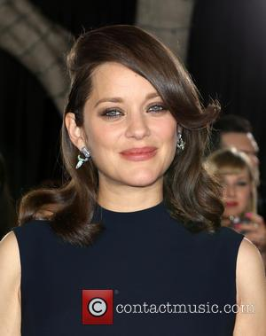 Marion Cotillard seen alone and with Brad Pitt at a fan event For Paramount Pictures' 'Allied' held at Regency Village...