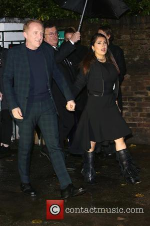 Salma Hayek and Francois-Henri Pinault at the showcase for Stella McCartney's 2017 menswear line held at Abbey Road Studios, London,...