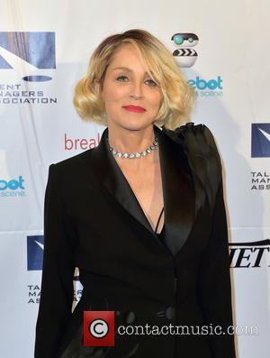 Sharon Stone Enjoys Vacation With New Man