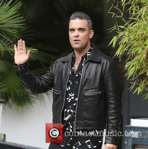 Robbie Williams and Ayda Field seen with their dogs outside ITV Studios - London, United Kingdom - Monday 14th November...