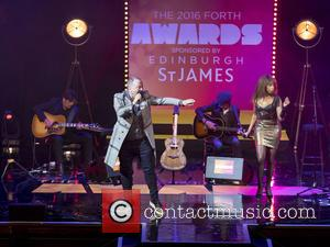 Simple Minds (Jim Kerr and Charile Burchill) perform on stage after picking up the Forth Best Performance Award at the...