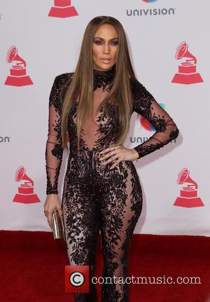 Jennifer Lopez And Marc Anthony Lock Lips At Latin Grammys