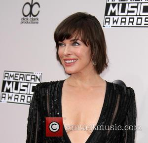 Milla Jovovich arrives at the 2016 American Music Awards held at the Microsoft Theatre, Los Angeles, California, United States -...