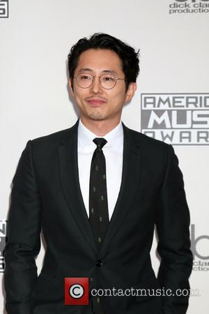 Steven Yeun arrives at the 2016 American Music Awards held at the Microsoft Theatre, Los Angeles, California, United States -...