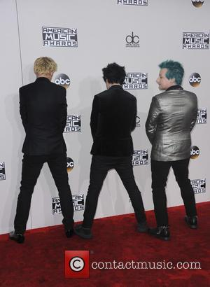 Green Day arrive at the 2016 American Music Awards held at the Microsoft Theatre, Los Angeles, California, United States -...