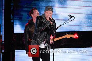 Ryan Tedder and the rest of OneRepublic perform at the halftime show during the 104th Grey Cup game in Toronto,...