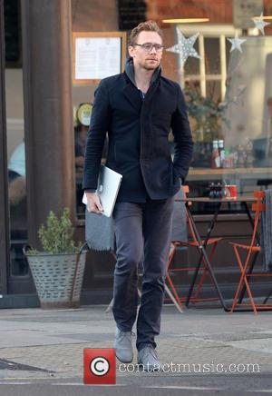 Tom Hiddleston out and about in North London carrying an Apple MacBook. - London, United Kingdom - Wednesday 30th November...