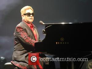 Elton John performing with his band live onstage at the SSE Arena in Belfast, Northern Ireland. Elton still has a...