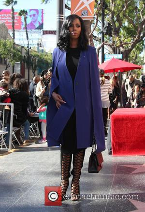 Tasha Smith seen alone and with Lee Daniels. Daniels Was Being Honored With His Own Star On The Hollywood Walk...