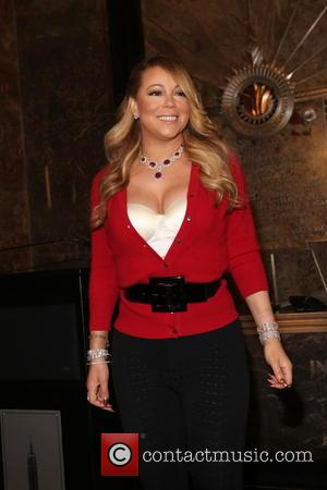 Beyonce Greets Mariah Carey Backstage At New York Show