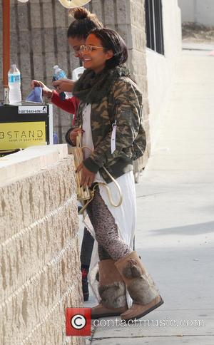 Christina Milian stops at a gas station to fill up her car and buy a bottle of water - Studio...