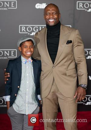 Terry Crews with his Son at the World premiere of 'Rogue One: A Star Wars Story' held at Pantages Theatre,...