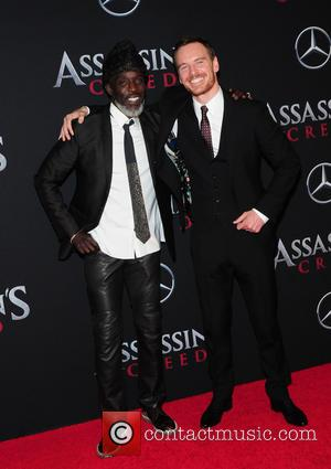 Michael Fassbender and Michael K. Williams