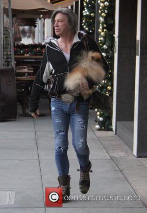 Mickey Rourke leaves Caffe Roma carrying his pet dog in Beverly Hills, Los Angeles, California, United States - Saturday 17th...