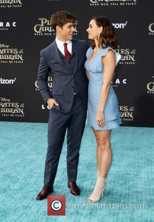 Brenton Thwaites and Chloe Pacey at the Premiere Of Disney's
