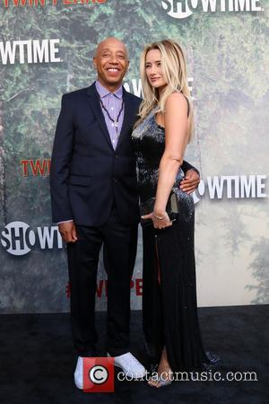 Russell Simmons and Amy Shiels at the premiere of Showtime's 'Twin Peaks' held at The Theatre at Ace Hotel -...
