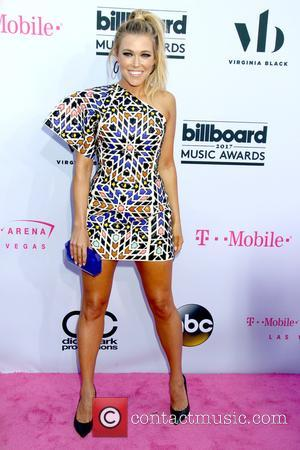 Rachel Platten on the red carpet at the 2017 Billboard Music Awards held at T-Mobile Arena. Drake walked away as...