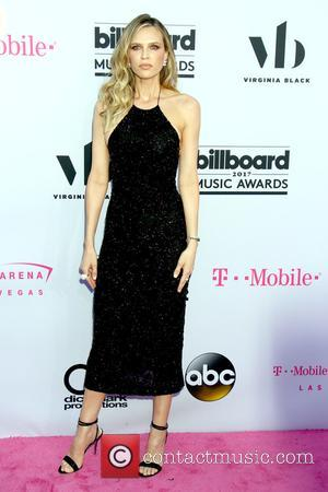 Sara Foster on the red carpet at the 2017 Billboard Music Awards held at T-Mobile Arena. Drake walked away as...