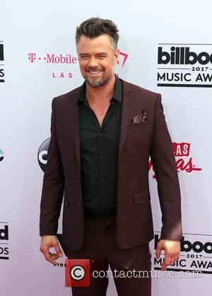 Josh Duhamel on the red carpet at the 2017 Billboard Music Awards held at T-Mobile Arena. Drake walked away as...