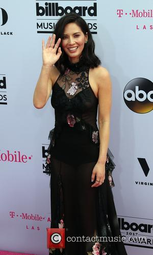 Olivia Munn on the red carpet at the 2017 Billboard Music Awards held at T-Mobile Arena. Drake walked away as...