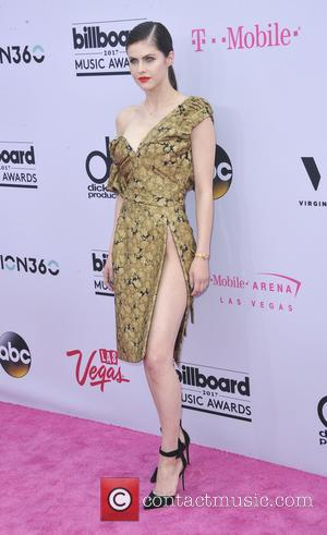Alexandra Daddario on the red carpet at the 2017 Billboard Music Awards held at T-Mobile Arena. Drake walked away as...