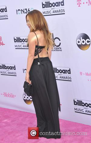 Ashley Tisdale on the red carpet at the 2017 Billboard Music Awards held at T-Mobile Arena. Drake walked away as...