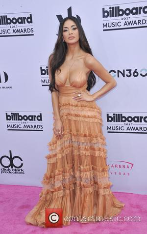 Nicole Scherzinger on the red carpet at the 2017 Billboard Music Awards held at T-Mobile Arena. Drake walked away as...